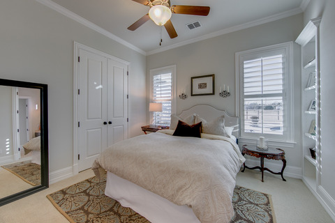 Transitional Bedroom with plantation style shutters