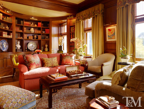 Traditional Library with dark wood stained millwork