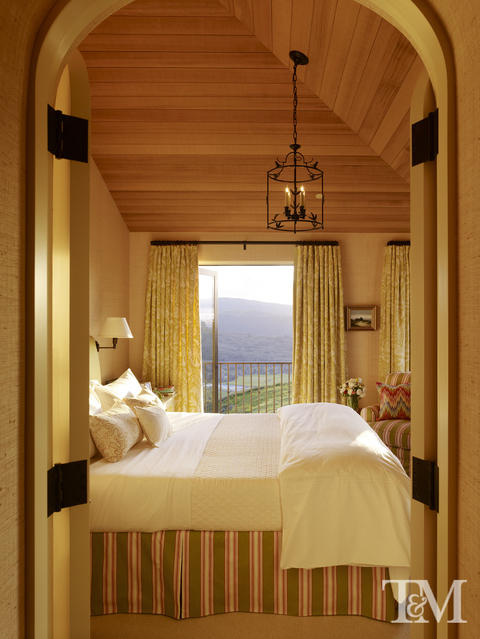 French Bedroom with light wood siding on ceiling