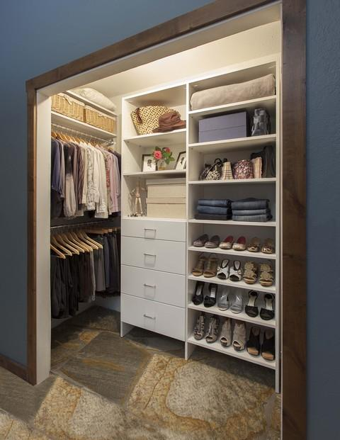 Casual / Comfortable Closet with wood passageway surround