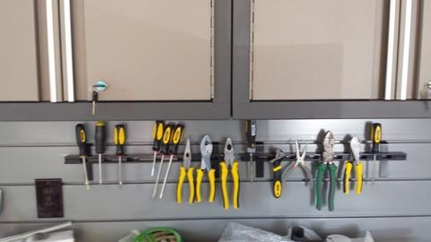 Casual / Comfortable Garage with space saver solutions for tools