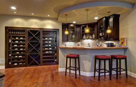 Traditional Basement with dark stained cabinetry