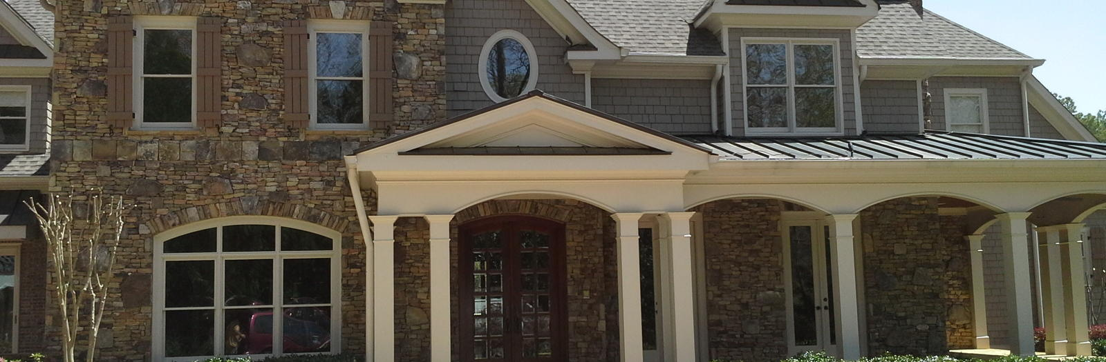 Traditional Home Exterior with french entry doorstone fireplace