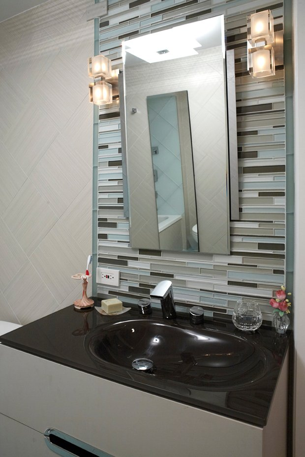 Modern bathroom in chicago angled mirror brown gray and pale blue by joseph associates Bathroom light fixtures chicago