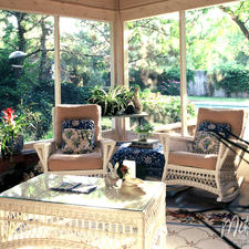 Traditional Sunroom with beige upholstered cushions