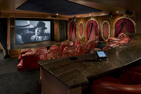 French Home Theater with red leather swivel barstool