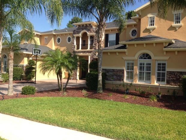 Contemporary Home Exterior In Winter Springs Balcony Mulched Bedding By C H Painting Llc