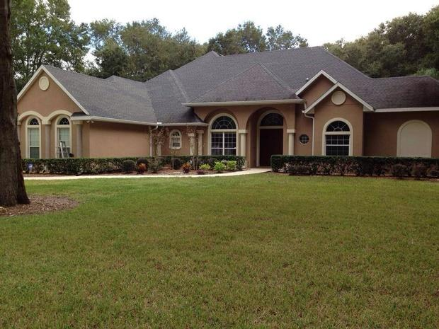 English Country Home Exterior In Winter Springs Painted Exterior Hedges By C H Painting Llc