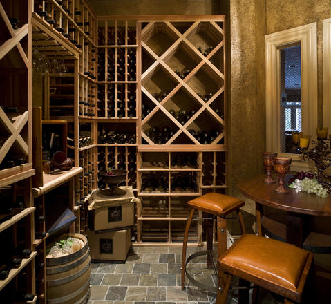 Traditional Wine Cellar with leather cushion barstools