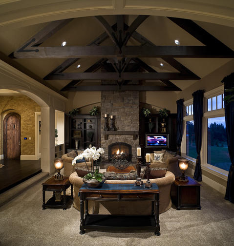 Traditional Family Room with stone fireplace surround