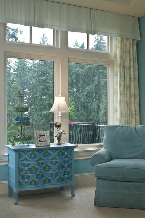Traditional Family Room with blue and white floral curtains
