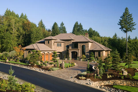 Traditional Landscape with stained wood garage doors