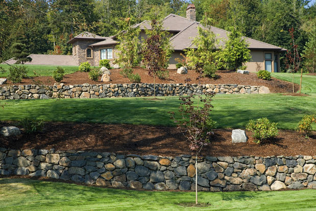 Traditional Landscape with stone retaining wall