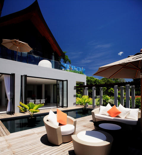 Modern Deck with woven outdoor furniture