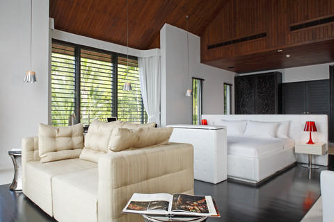 Contemporary Family Room with black wood stained floor