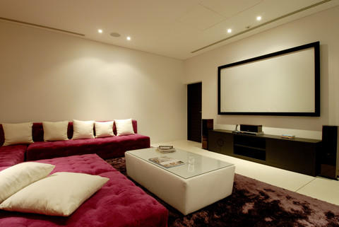 Modern Home Theater with white ottoman table