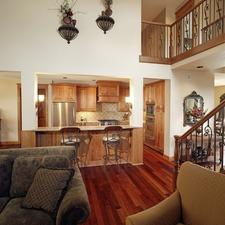 Traditional Family Room with dark wood and black metal stair railing