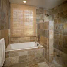 Traditional Master Bathroom with tile bath surround