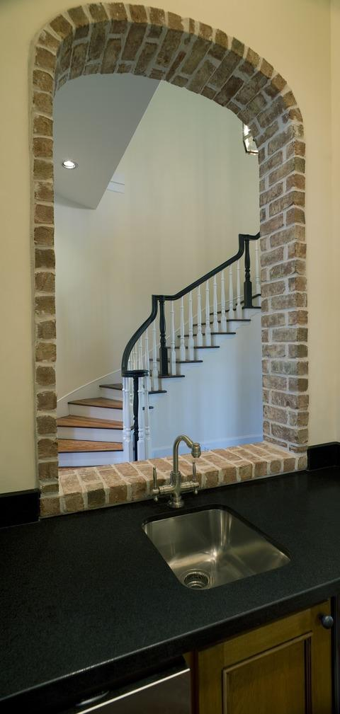 Traditional Staircase with wood and white banister