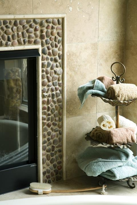 Traditional Master Bathroom with river rock fire place surround