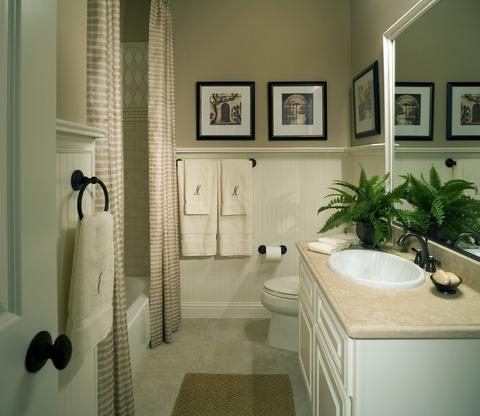 Traditional Bathroom with beige and white striped shower curtains