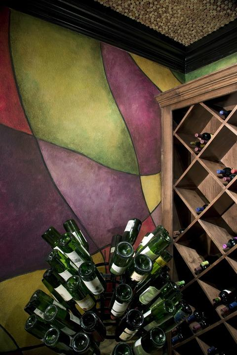 Eclectic Wine Cellar with built in wine storage