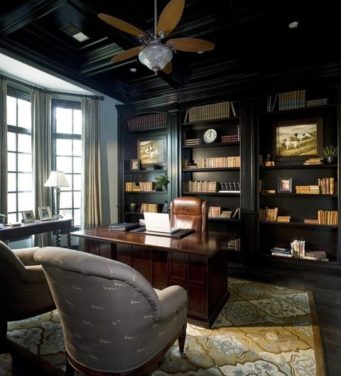 Traditional Library with black stained wood floor