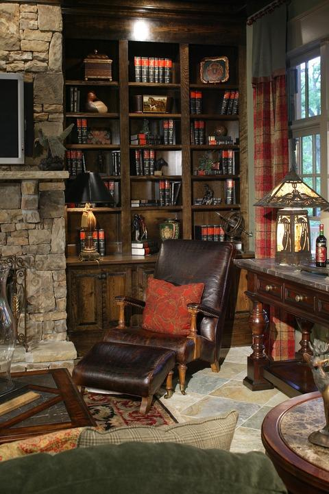 Traditional Library with dark wood built in book shelves
