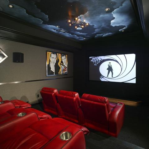 Contemporary Home Theater with red leather upholstered chairs