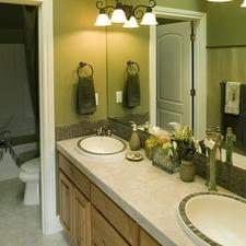 Traditional Master Bathroom with medium wood stained vanity cabinet