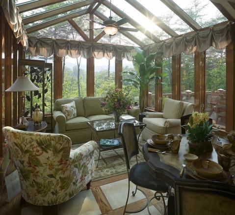 Transitional Sunroom with glass topped tea table