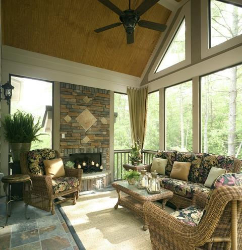 Traditional Sunroom with dark floral print cushions