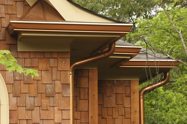 Transitional Home Exterior with copper gutters