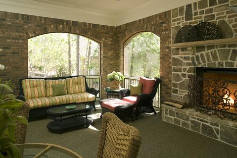 Traditional Sunroom with slate tile fireplace surround