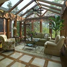 Traditional Sunroom with floral upholstered chair