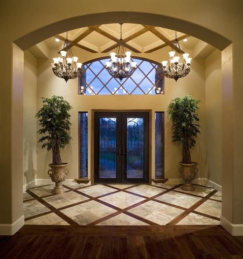 Tuscan Entry with tall slender windows along side of door