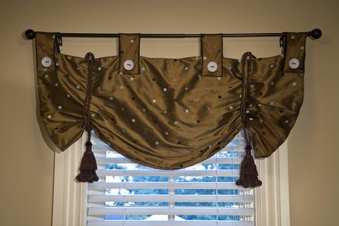 Traditional Bedroom with brown silk window valance