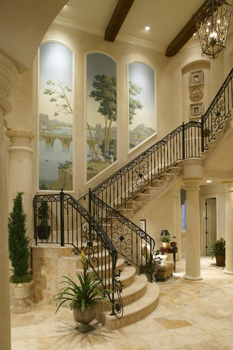 Traditional Entry with wrought iron railing
