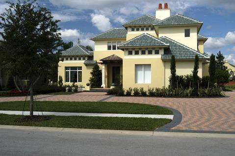 Traditional Driveway with gold painted home exterior