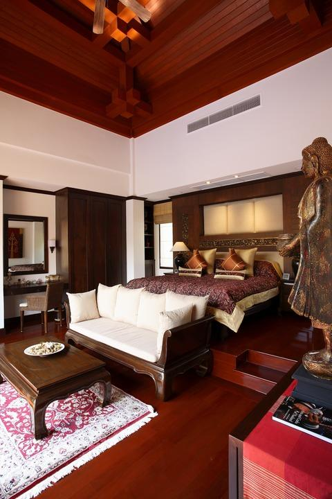 Asian Bedroom with large dark cherry wood ceiling beams