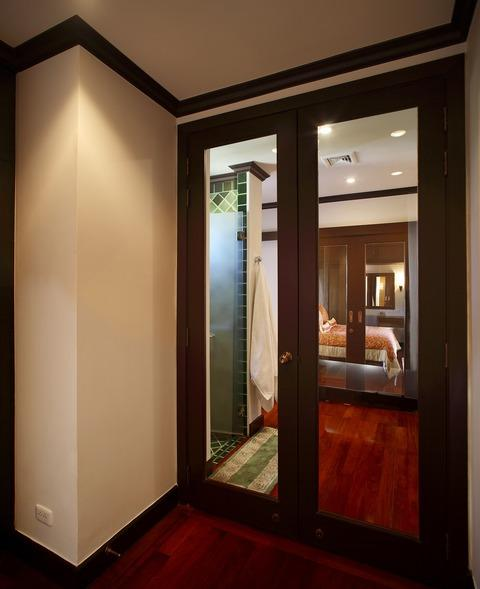 Traditional Hallway with dark wood stained millwork