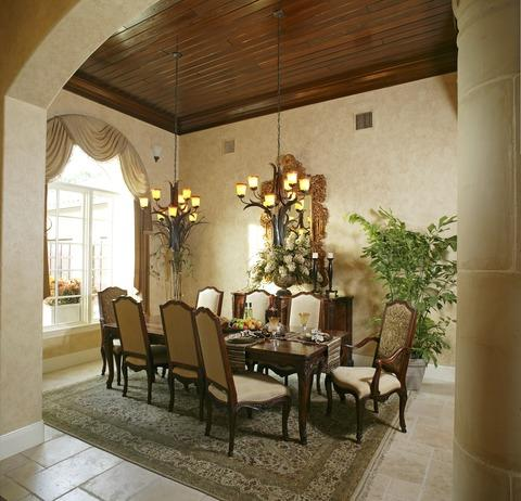 Traditional Dining Room with light gold custom window treatment