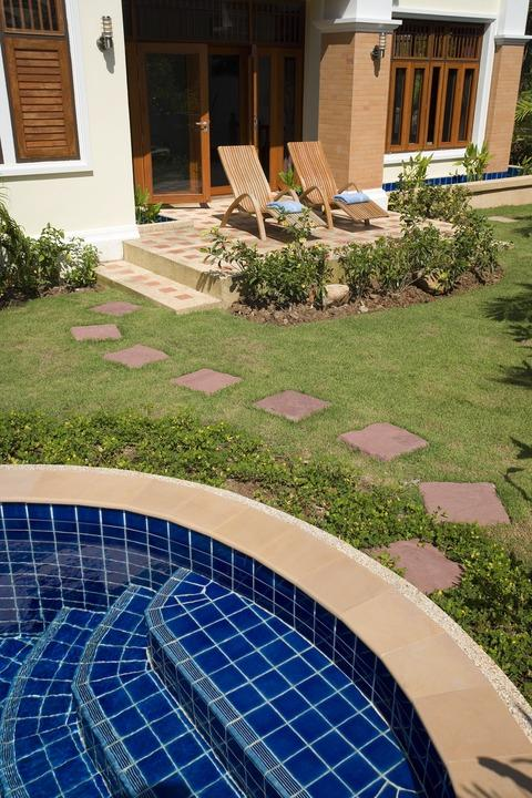 Traditional Patio with red brick stepping stones
