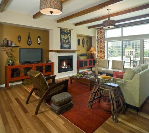 Eclectic Family Room with stained wood ceiling beams