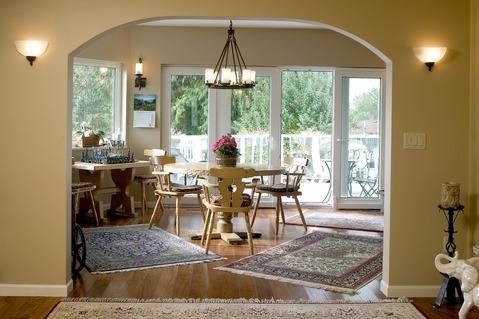 Transitional Dining Room with yellow painted wood chairs
