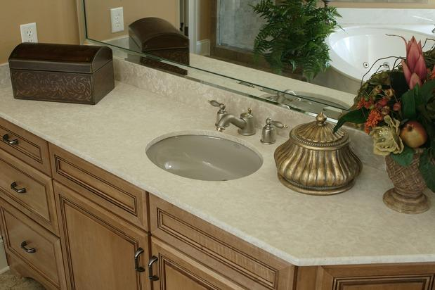 Contemporary bathroom photo corian countertop tile for Corian countertops cost per sq ft