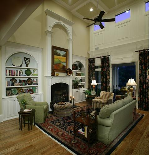 Traditional Family Room with large white wood built-in book shelves