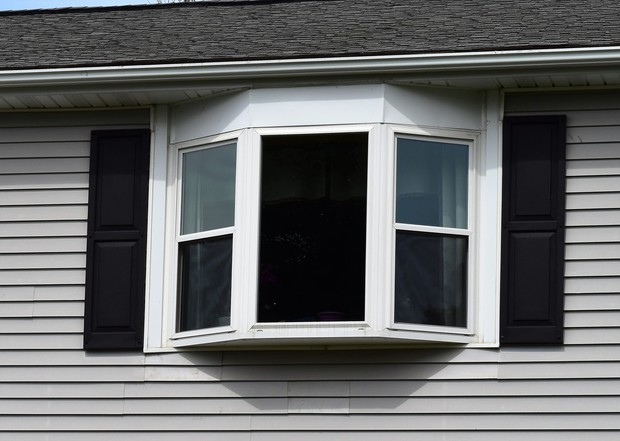 Contemporary Home Exterior In Providence Bay Window Shingled Roof By Ven