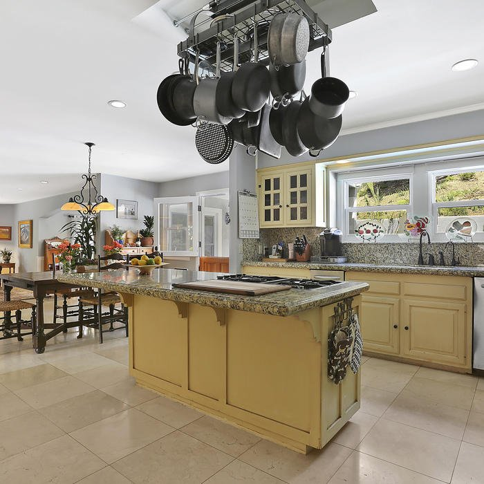 Pots and Pans Hanging Over Kitchen Island