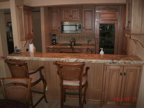 Traditional Basement with beige counter height granite countertop